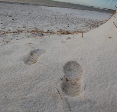 footprints in the snow on Walberswick Beach