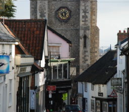 an old street in Diss, with the Church clock tower in the background