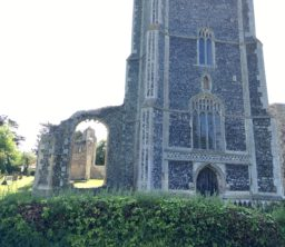 The imposing square flint tower and ruined aspects of St Andrew's Church, Walberswick