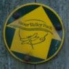 Stour Valley Path green and yellow waymarker disc on wooden post